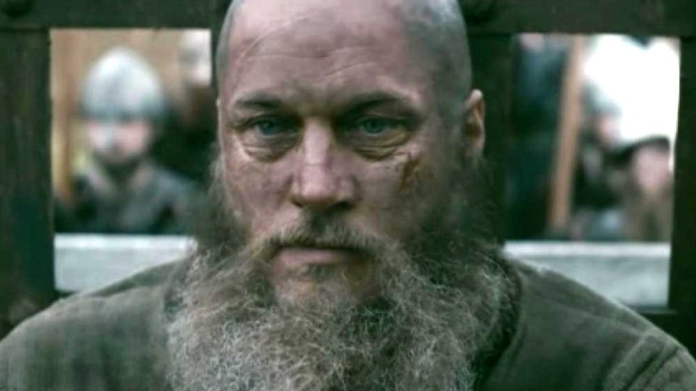 Travis Fimmel as a bearded Ragnar staring intently on Vikings