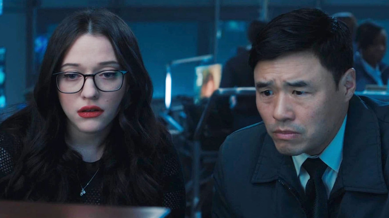 Jimmy Woo and Darcy Lewis looking at screen