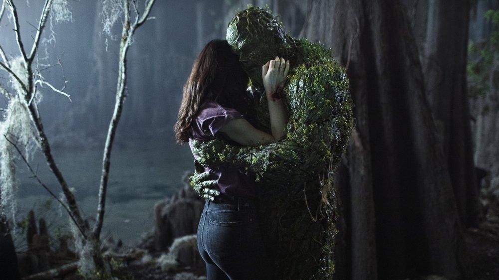 Crystal Reed and Derek Mears in Swamp Thing