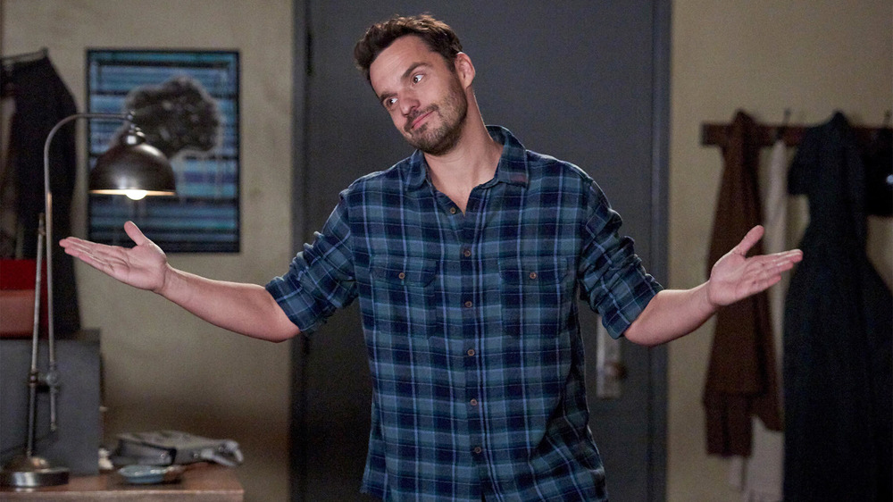 Jake Johnson shrugging New Girl