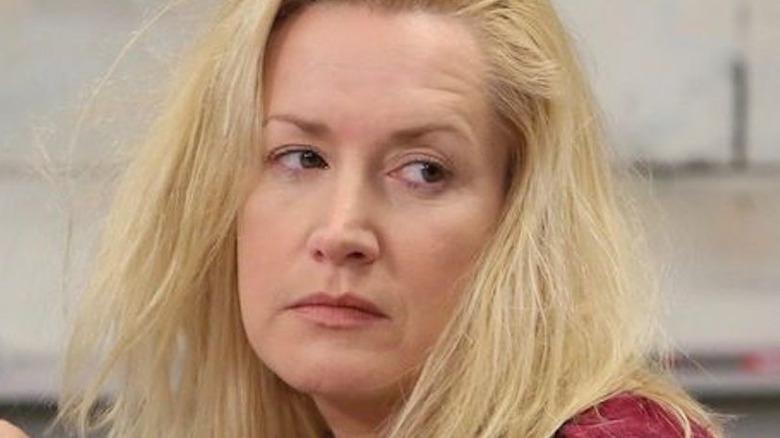 Angela looking disheveled