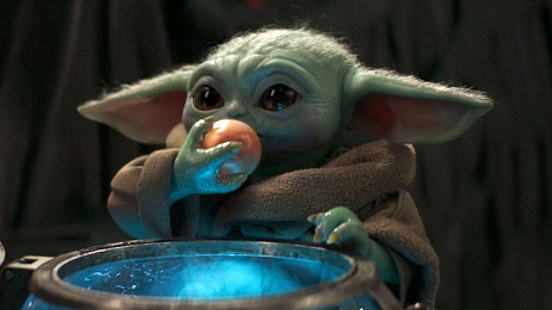 Baby Yoda eating an egg on The Mandalorian