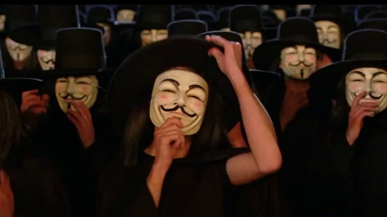 Mob in Guy Fawkes masks