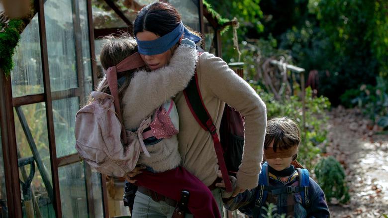 Sandra Bullock, Vivian Lyre Blair, and Julian Edwards in Bird Box