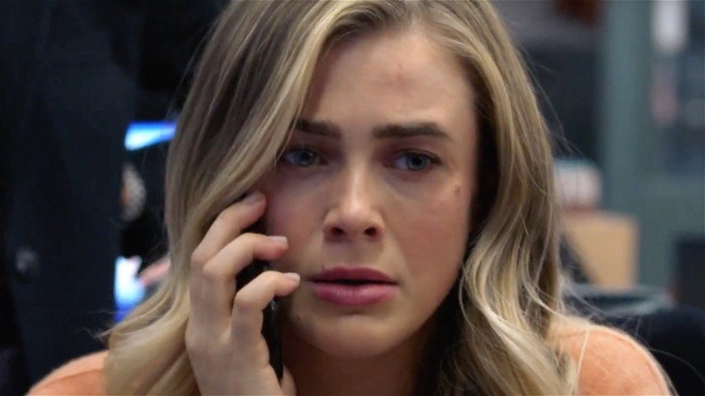 Michaela Stone looking concerned while on the phone