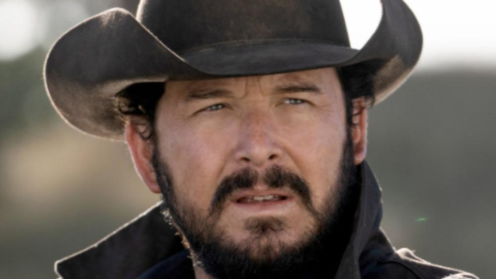 Rip Wheeler wears a cowboy hat