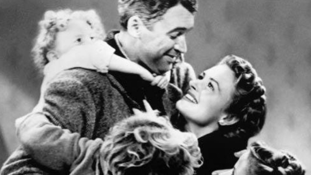 George Bailey (Jimmy Stewart) lifts up Zuzu in It's A Wonderful Life