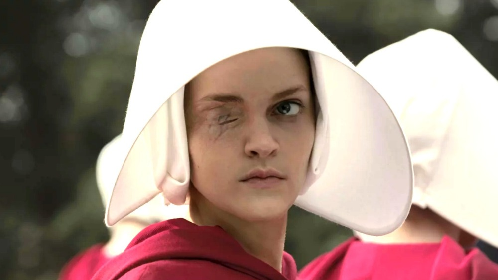 Janine in handmaid's outfit
