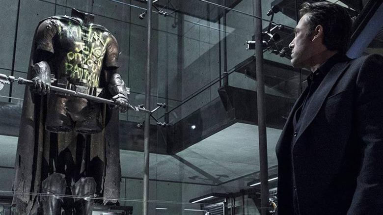 Bruce Wayne looks at Robin's old costume in Batman v Superman: Dawn of Justice