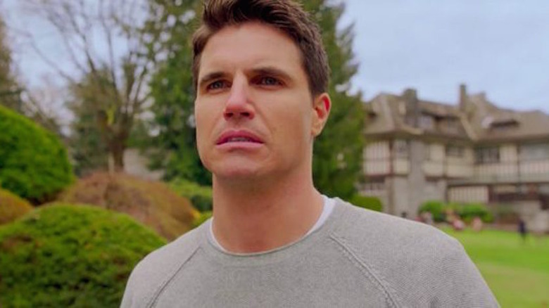 Robbie Amell as Nathan on Upload