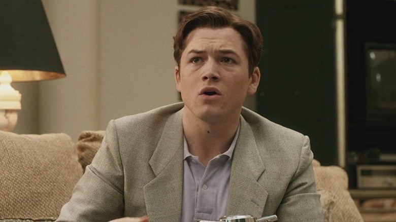 Taron Egerton as Dean Karny in Billionaire Boys Club
