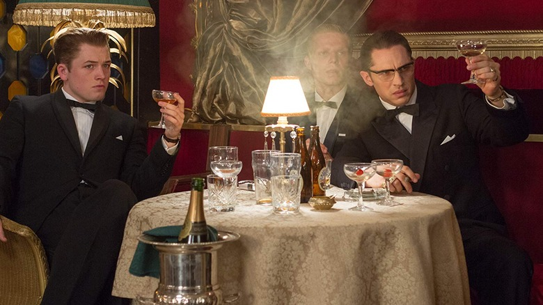 Taron Egerton, Charley Palmer Rothwell, and Tom Hardy in Legend