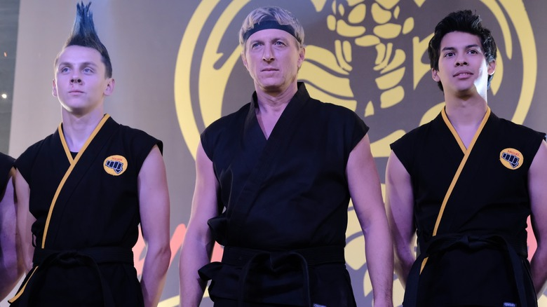 William Zabka as Johnny Lawrence leads his two best students in Cobra Kai