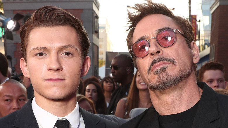 Tom Holland and Robert Downey Jr. attend the premiere of Spider-man: Homecoming in 2017.