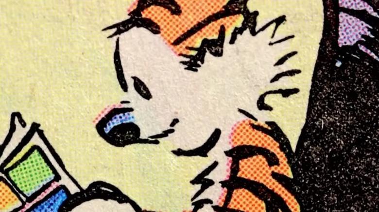 Hobbes reading comics